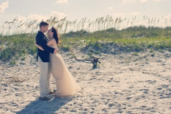 The bride and groom steal an extra kiss in front of the dunes at Little Talbot Island.